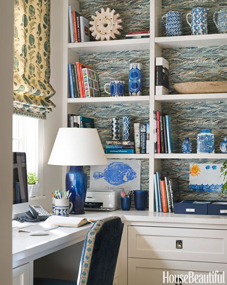 Coastal decorated bookcase with a marble inlufenced wallpaper inlay