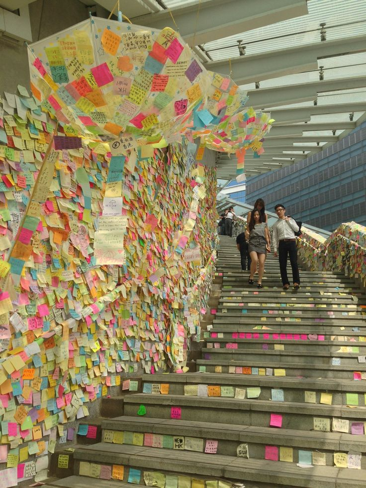 """""""Named for the Beatles legend and protest icon, the """"Lennon Wall"""" is a colorful collage of sticky notes with handwritten messages from democracy demonstrators.""""  -- Huffington Post"""