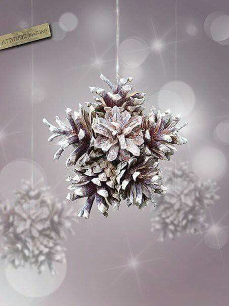 Recycle a small round ornament, lightly spray pinecones with white spray paint, paint the tips with white craft paint and glue in pinecones. Hang with twine for a rustic touch. Suspend them from a window sill, a chandelier or your tree.