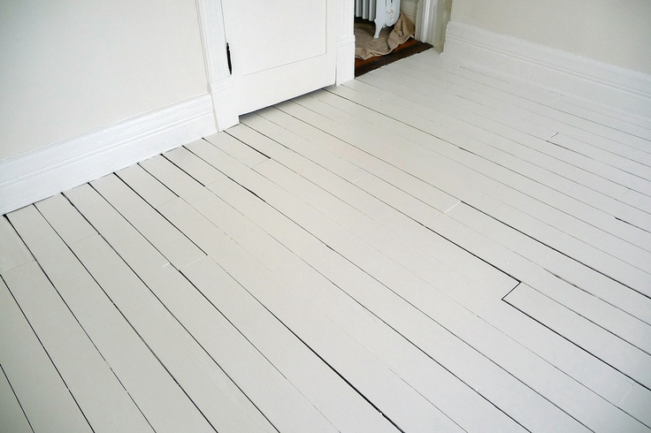 blog with step by step  on how to paint a wood floor.