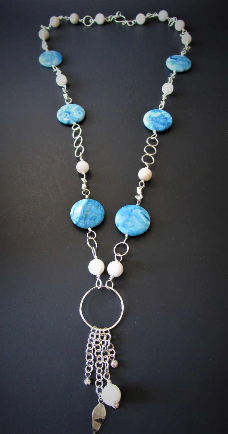 Beachy blue Crazy Lace Agate beads accompanied by hand forged sterling silver chain and details. coordinated with Snow Quartz beads. Click the image to purchase on Etsy!