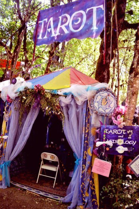 tarot booth -- love the set-up -- maybe taken at a renaissance festival?