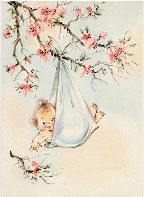 Baby retro image baby hanging from a bough of flowering branch