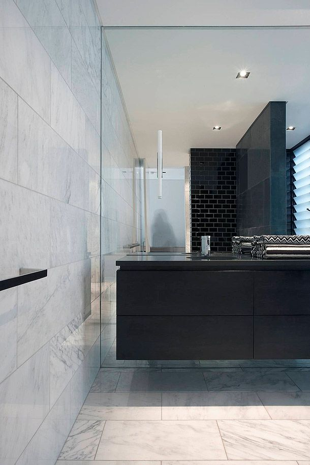 Annandale House, residential project in Australia by Adams Architects _note  use of marble on floor and wall. Particular note of floor to  ceiling mirror . detail of floating cupboards and raked joinery between basin top and cabinet