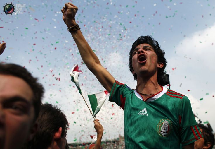 100. Mexican fans celebrate Mexico's goal, which was annulled, as they watch the 2010 World Cup opening match against South Africa on a large TV screen in Zocalo Square, downtown Mexico City June 11, 2010. REUTERS/Eliana Aponte