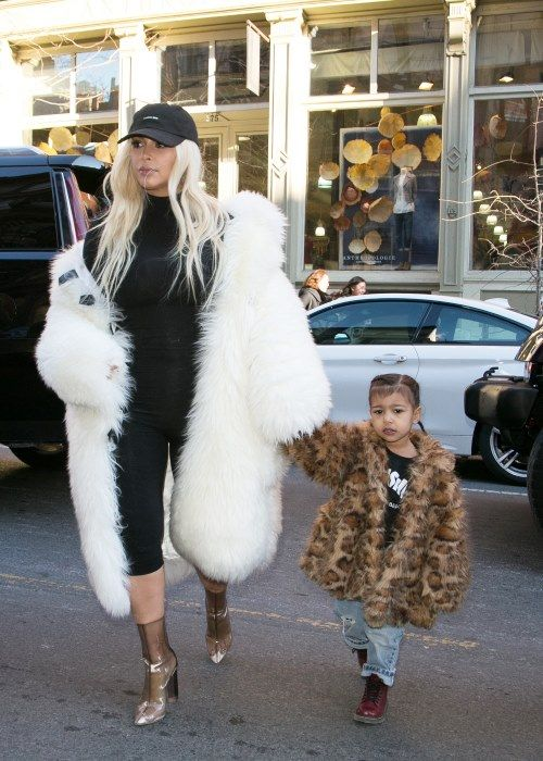 Kim and North wear fur coats during #NYFW North wears animal print coat; Kim wears white coat