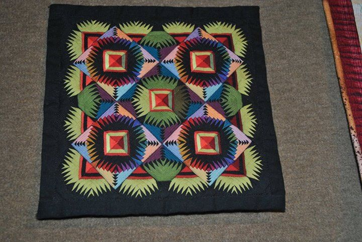Small, Medium and Large by George Siciliano. This quilt is 6 inches by 6 inches.
