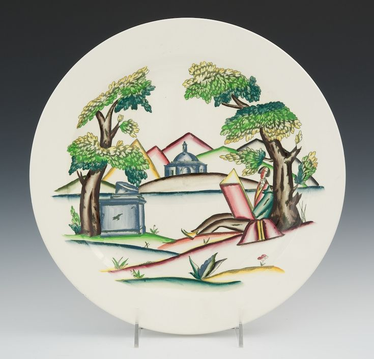Guido Andlovitz  - Lavenia, ca. 1927-30 - A high gloss glazed ceramic plate decorated in polychrome with a stylized pictorial image depicting a man seated under a tree in a landscape, mountains and a domed building in the distance