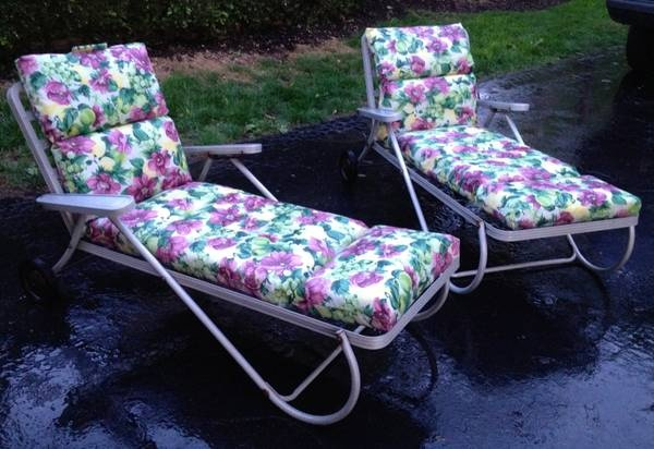 Aluminum lounge chairs, love 'em. But I would recover the cushions with a more mid-century looking fabric.