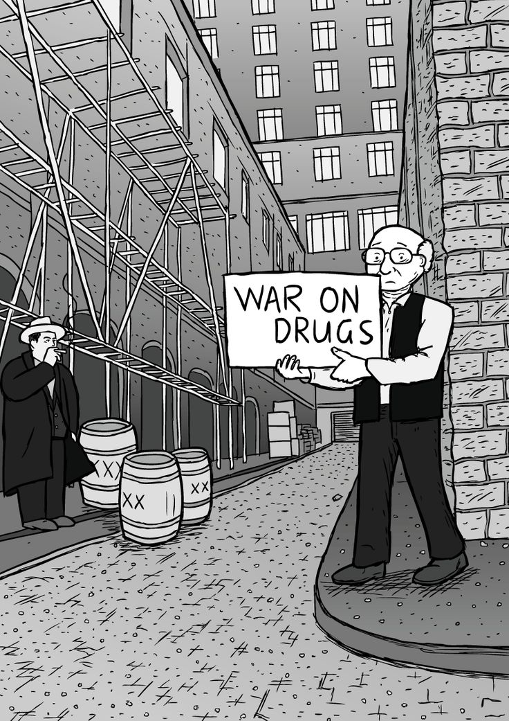 Milton Friedman in alleyway holding 'War on Drugs' sign with Al Capone in the background. Image from Stuart McMillen's comic War on Drugs.