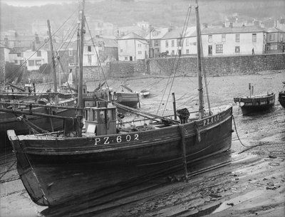 'Boy Willie', Mounts Bay mackerel driver, dried out in Mousehole harbour…