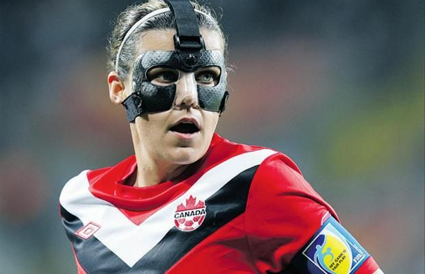 Canada's Christine Sinclair, wearing a mask to protect her broken nose, looks on during their July 5 World Cup loss to Nigeria in Dresden, Germany.