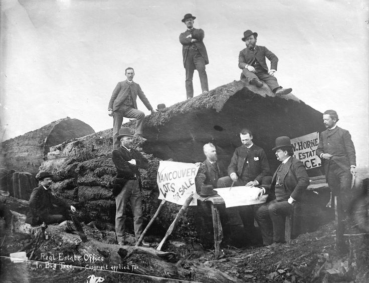 1886: J.W. Horne's real estate office in hollow log at approximately Georgia and Granville (today)