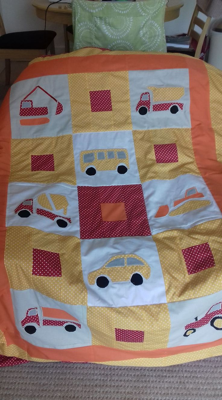 Used MSWord Icon Vehicle images as pattern pieces for turned applique method.   I sewed straight through the printed paper rather than cutting out the pattern pieces. A darning or fmq foot was very useful for the wheels and sharpely curved edges.