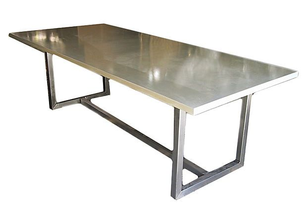 The beautifully clean design of this table makes it one of the most versatile pieces. The creamy tone of the concrete and the matte satin finish on the stainless steel give it a light and polished look. This table will center any space, be it a breakfast nook or a boardroom.