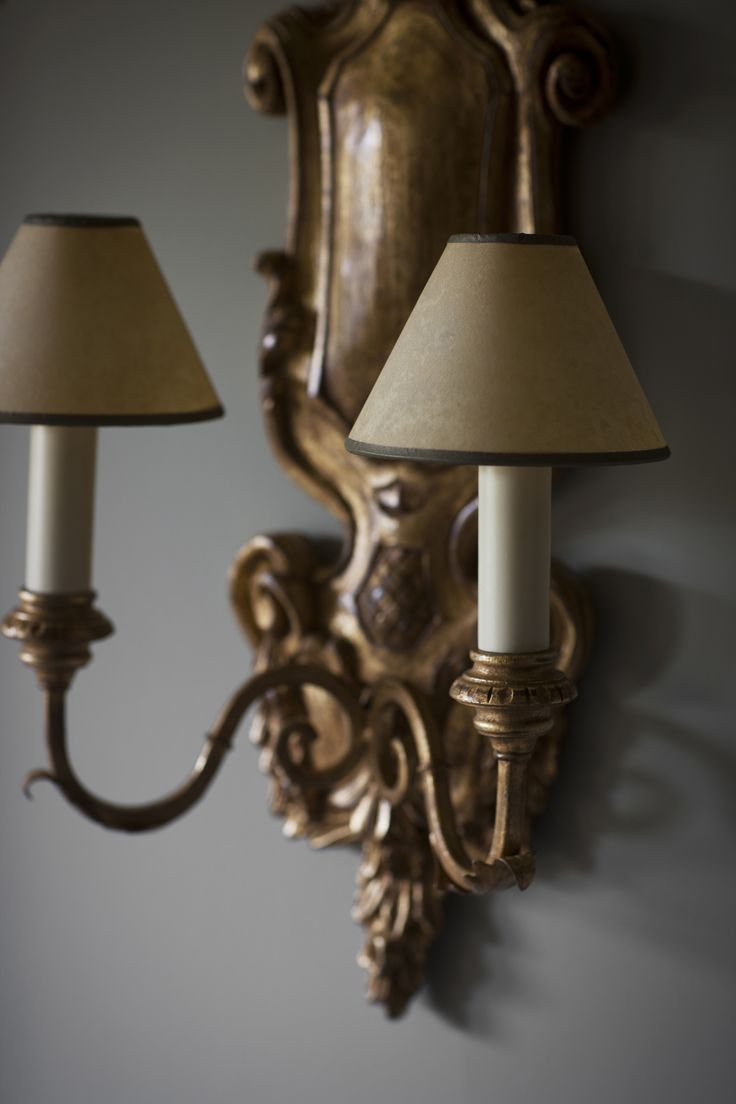 Our Rococo wall light is beautifully carved and will give instant warmth on cold and wet evenings. Finish shown here in burnt gold.