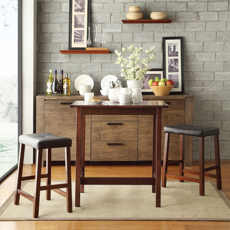 This classy pub-style dining set is the ideal dining solution for up to two people. This set is perfect for singles or couples who do not need a full dining set. It can also be used for additional dining space during gatherings and celebrations.
