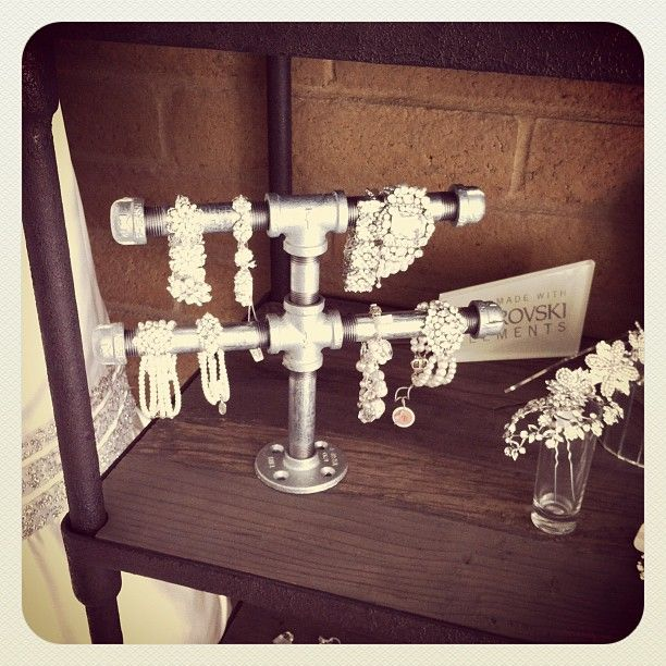 Bracelet display from from plumbing fixtures.