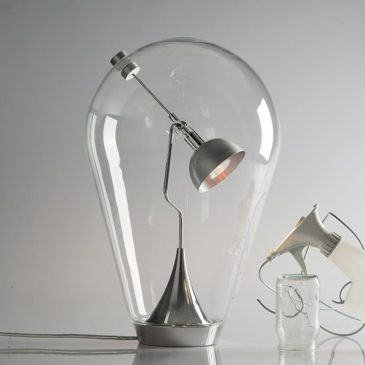 Inspirational Blow Table lamp is a a hand blown crystal glass table lamp in the shape of an inverted teardrop which encases the lamp on the inside