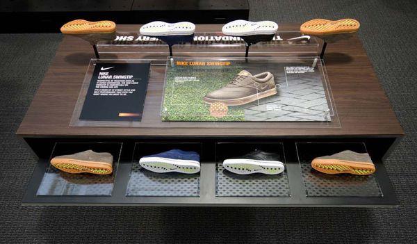 Nike Golf footwear display table on Behance