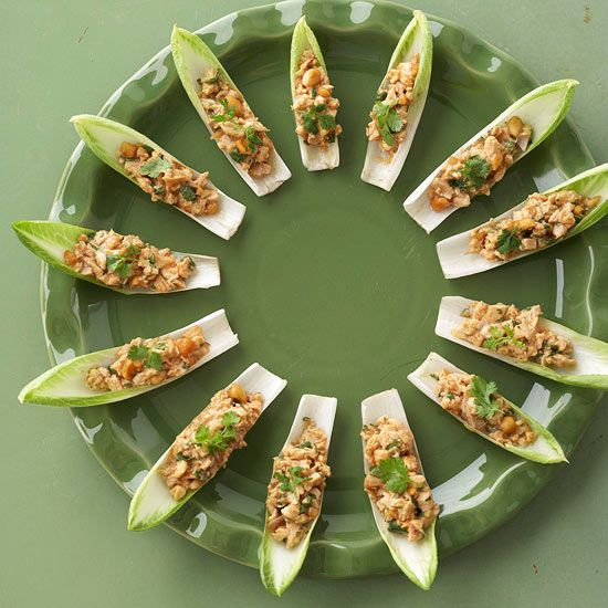 Endive Chicken Boats - At only 80 calories per serving, this savory Asian-inspired appetizer recipe makes the perfect Thanksgiving starter. Brown sugar adds a sweet flavor that complements the hearty chicken and peanuts in the make-ahead dish. Don't have endive leaves? Use lettuce leaves instead.