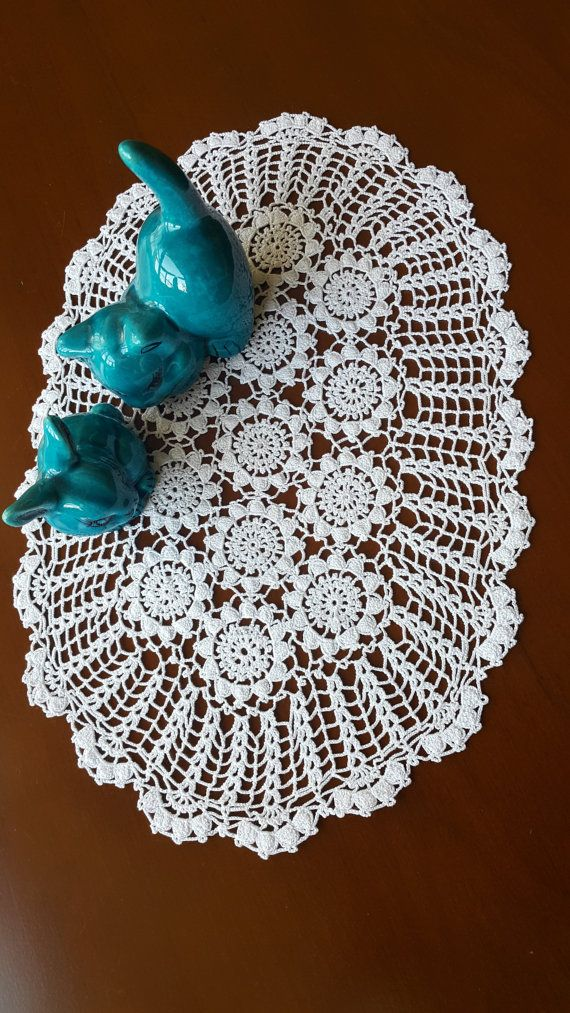 Check out this item in my Etsy shop https://www.etsy.com/listing/449175696/home-decor-white-oval-hand-crochet-doily