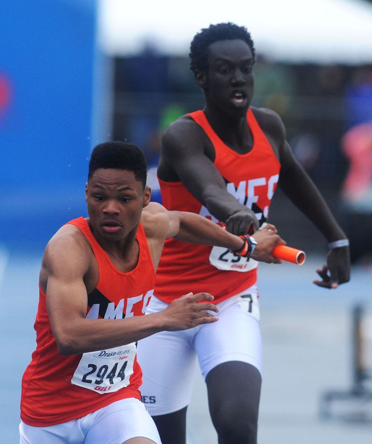 Ames' DaiSean Brooks takes the baton from Chuol Chuol during the high school boys 4x400-meter relay at the Drake Relays on Saturday at Drake Stadium in Des Moines. Ames finished sixth. Photo by Nirmalendu Majumdar/Ames Tribune http://www.amestrib.com/sports/20170429/little-cyclones-turn-in-strong-showing-with-pair-of-top-six-relays-at-drake