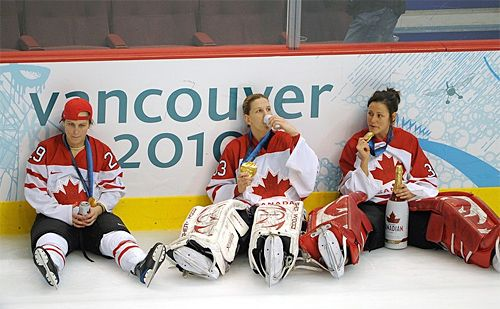 Canada's Women's Hockey Team celebrated their gold medal Canadian style: with beer and cigars.
