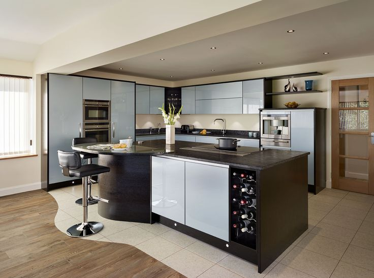Callerton Contemporary Kitchen Featuring The Abstract Cubic Feature Panels in Hacienda Black and the Milan Blue Steel Acrylic Gloss Door.