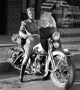 As early as 1920, Motor Company advertising and photos frequently featured women in riding attire, posing with the latest motorcycles, ready to set off on their adventures.