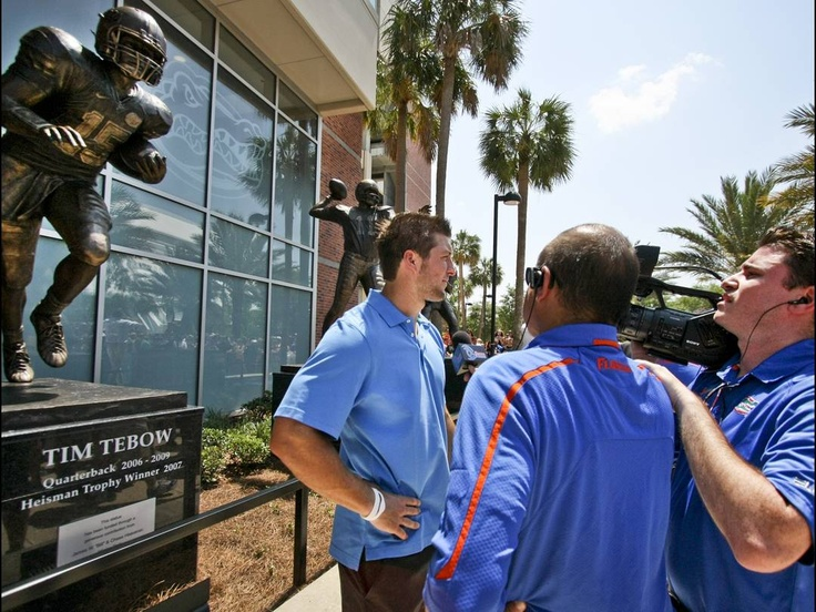 Tebow and his statue outside Ben Hill Griffin Stadium~