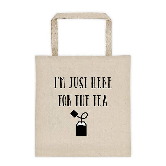 """I'm just here for the tea tote bag   Rupaul's drag race   drag quotes   funny totes   What is the tea? its the truth baby, and we know you're thirsty!   A roomy tote bag with a square bottom that'll hold whatever you need to carry henny.   • 100% cotton canvas • Dimensions: 14 ¾"""" x 14 ¾""""  • Dual 22"""" handles • Reinforced bottom  #rupaulsdragrace #rupaul #tea #totebags #grocerybag"""