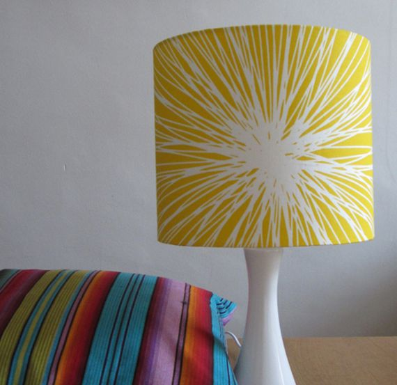 Dramatic modern bright yellow lampshade that features a stunning scandinavian design fabric the fabric features a sunburst style design in white with a