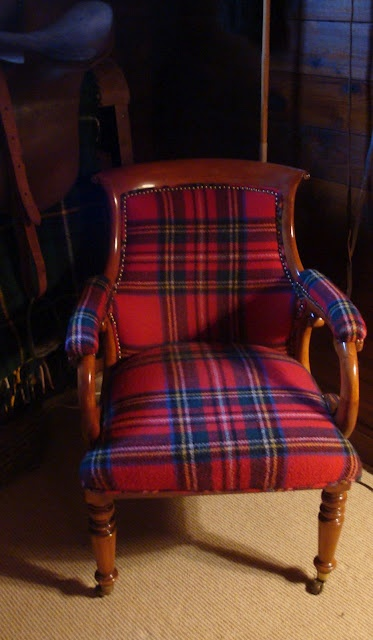 Brilliant use of vintage plaid blanket to reupholster chair