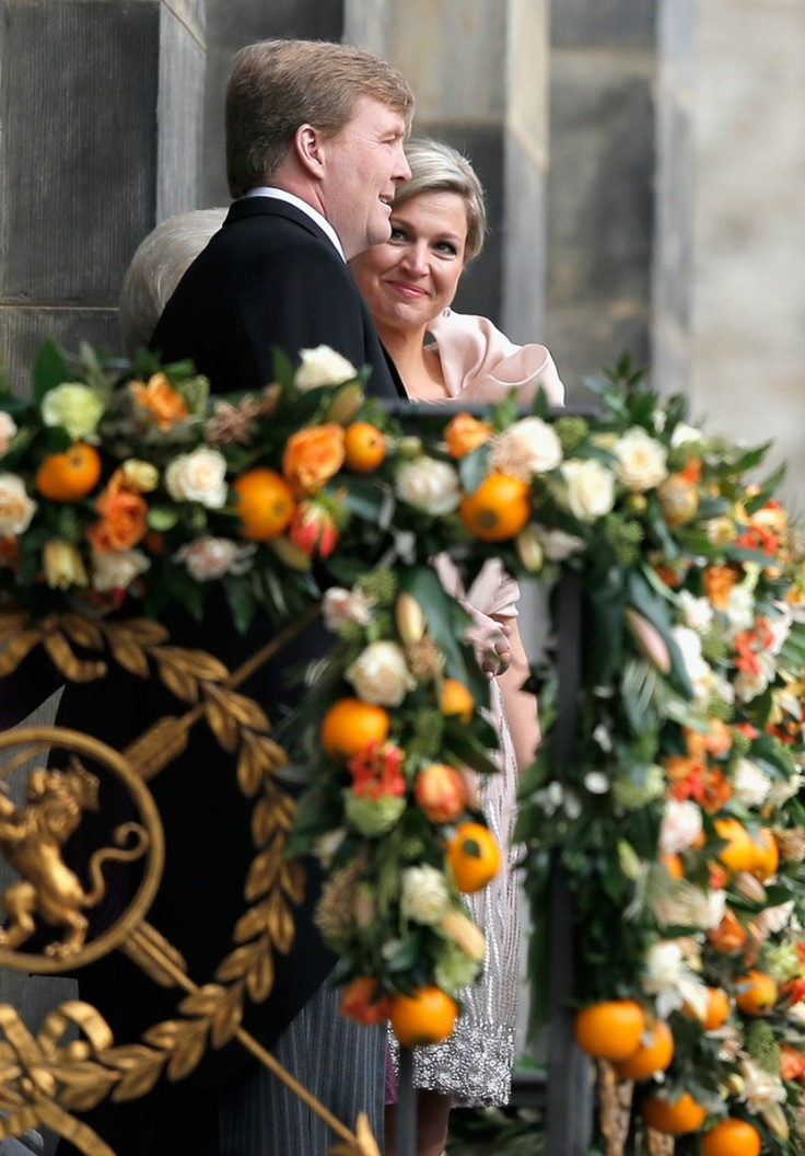 Queen Maxima looks lovingly at her husband the new King of Holland 4/30/13
