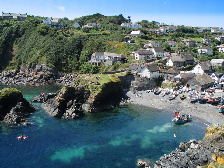 Cadgwith Cove, Cornwall, England is one of those Cornish fishing villages that time seems to have passed by. The beach is still very much the centre of the village with a small fleet of crabbing boats winched up on the beach in front of the boat houses. Gorgeous <3
