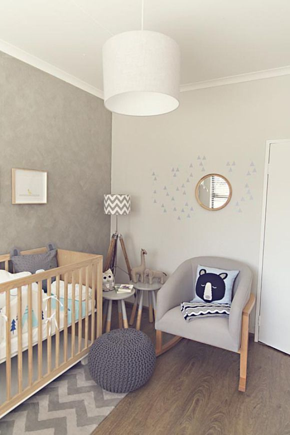 Gender neutral nursery design in white, gray, beige, and tan featuring a drum light fixture, taupe accent wall, and gray chevron patterns - Neutral Nursery Ideas & Decor