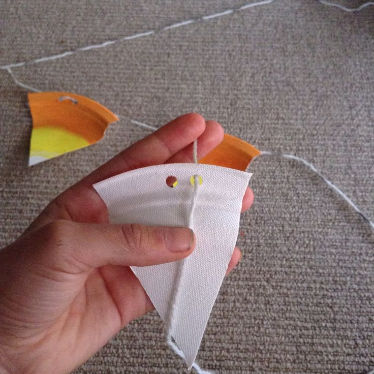 candy corn bunting made out of a paper plate