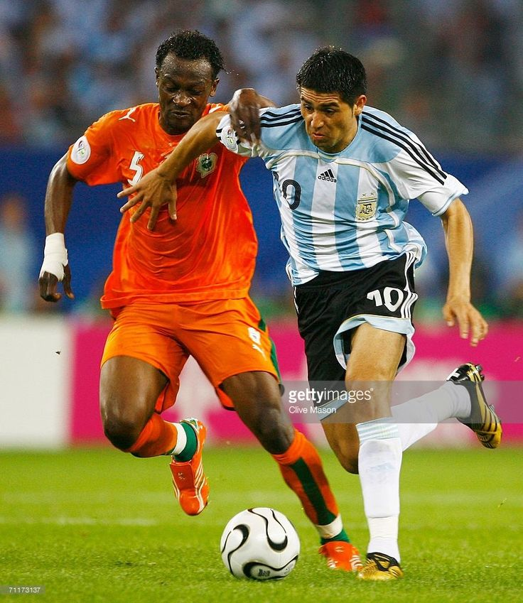 Juan Riquelme of Argentina fights for posession with Didier Zokora of Ivory Coast during the FIFA World Cup Germany 2006 Group C match between Argentina and Ivory Coast played at the Stadium Hamburg on June 10, 2006 in Hamburg, Germany.