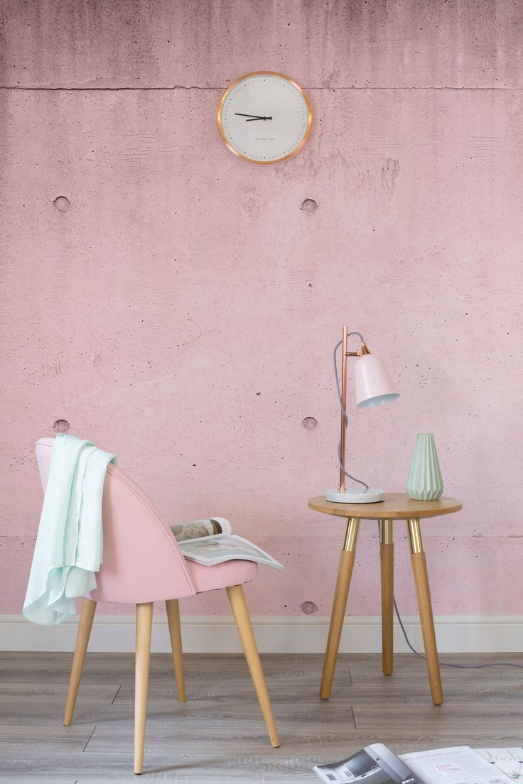Loving mint green and blush pink together! This pink concrete wallpaper is  delightfully modern and brings intrigue to your walls. Perfect for contemporary living room spaces.