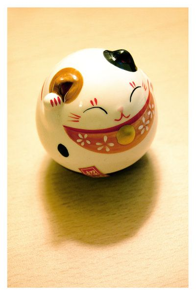 """The Japanese Maineki-Neko (""""lucky cat"""") is a good luck charm! The cat's paw is beckoning customers into an establishment, which is why you will often see them in stores and restaurants."""