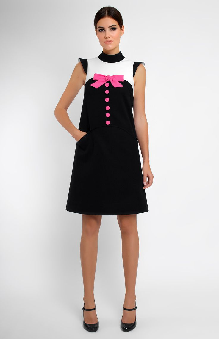 Black-and-white cotton A-shape dress. Band collar. Hidden back zip closure. Cap sleeves. Designer handmade genuine wool bow. Side pockets.