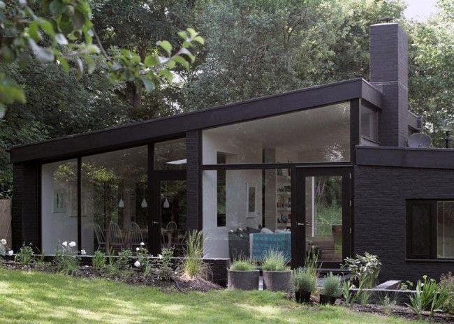 House Made From Black Bricks By Takero Shimazaki and Charlie Luxton
