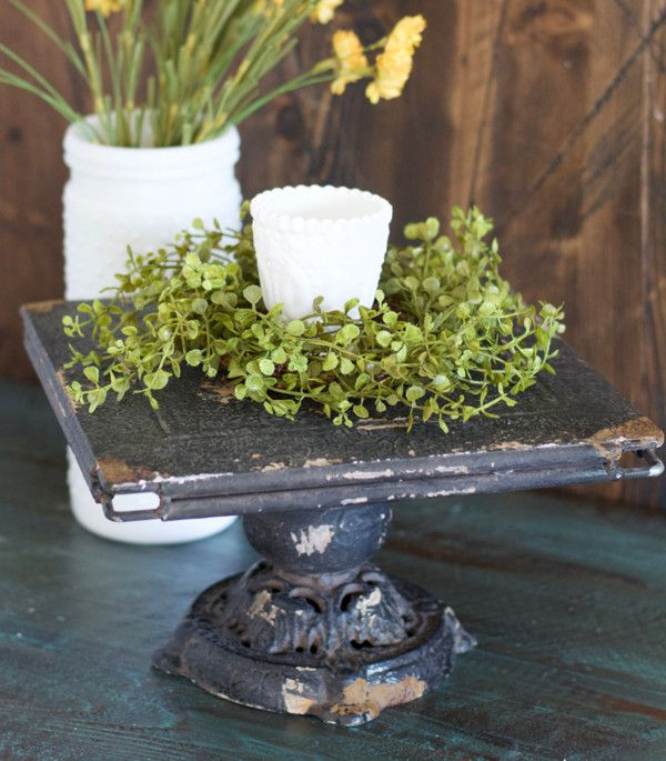 "Our Black Shabby Chic Cake Stand is great for entertaining! This is perfect to display sweets or as a vintage inspired centerpiece! - Top: 10 1/2"" X 10 1/2"" - Height: 6"" - Metal with a distressed fini"