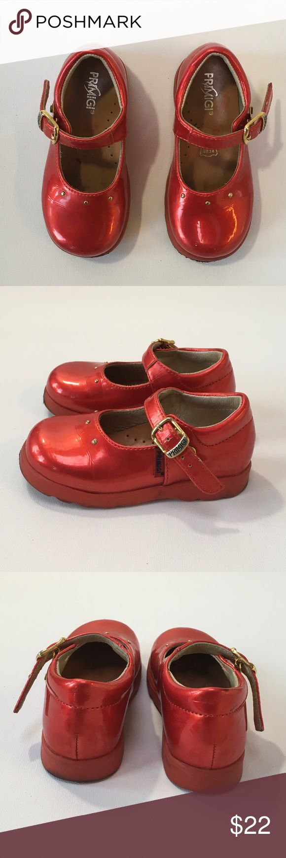 Primigi Red Patent Mary Janes 23 (US 6.5) Shiny red patent mary janes by Primigi. Size 23 approximately 6.5 toddler US (see size chart). Gold tone buckles. Some signs of wear, but tons of life left in these beauties! Primigi Shoes Dress Shoes
