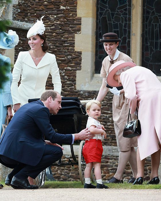 Prince George has a chat with Grandma after the service, probably about the throng of people staring at them. :)