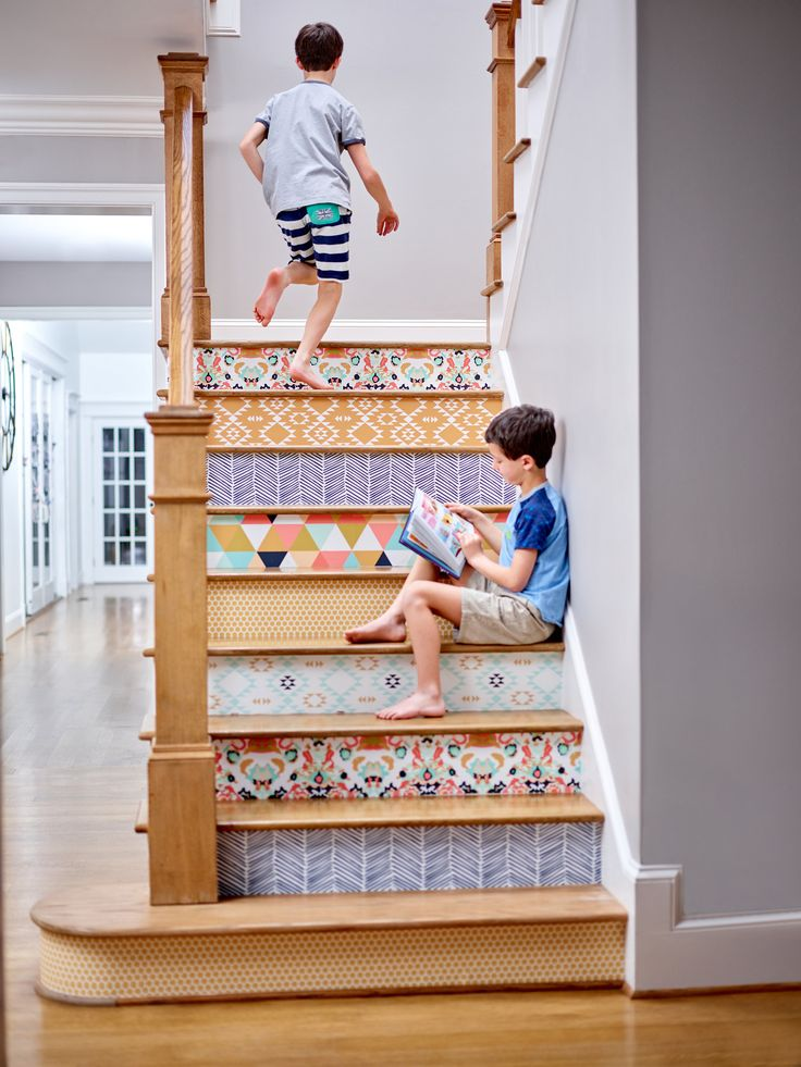 Bring new life to an old staircase by adding peel-and-stick wallpaper to each step.  Mix and match colors or choose a unified theme!  Click to see 15 ways to use Removable Wallpaper to brighten up your home.