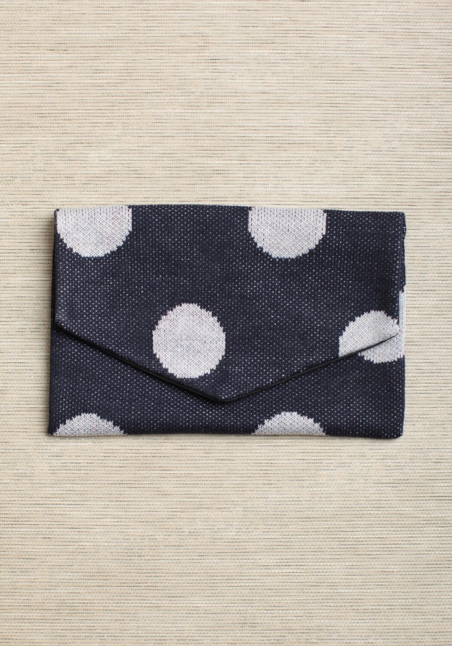 """Cloud Watching Polka Dot Clutch By Hansel From Basel 19.99 at shopruche.com. Perfect for holding all of your essentials in style, this impossibly soft envelope clutch is delicately crafted in a navy and ivory polka dot knit with a woven black interior. Finished with a hidden magnetic snap closure.9.5"""" x 6.25"""""""