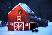 Bright red barn decorated with a large holiday wreath makes for a heartwarming seasonal winter image.    The natural light of dusk creates a cool blue hue on the snow which is juxtaposed to the warm tones of the barn illuminated by tungsten spot lamps.     This image has been published in the Scenic Connecticut 2012 calendar as the December feature and has also been used for Holiday greeting cards.  Recently has been licensed for commercial website use specifically for the 2012 holiday…