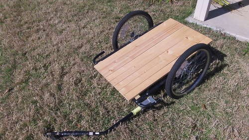 Converting a bicycle child trailer into a cargo trailer. Perfect for moving rocks and plants around the garden